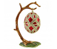 Egg box in the style of Faberge on a branch