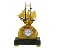 A ship made of amber with a clock on a granite pedestal